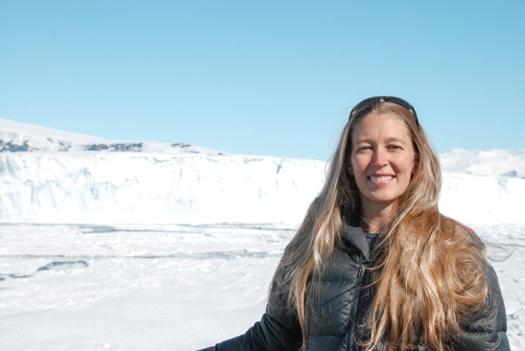 A woman (Christina Riesselman) stood in front of a polar landscape